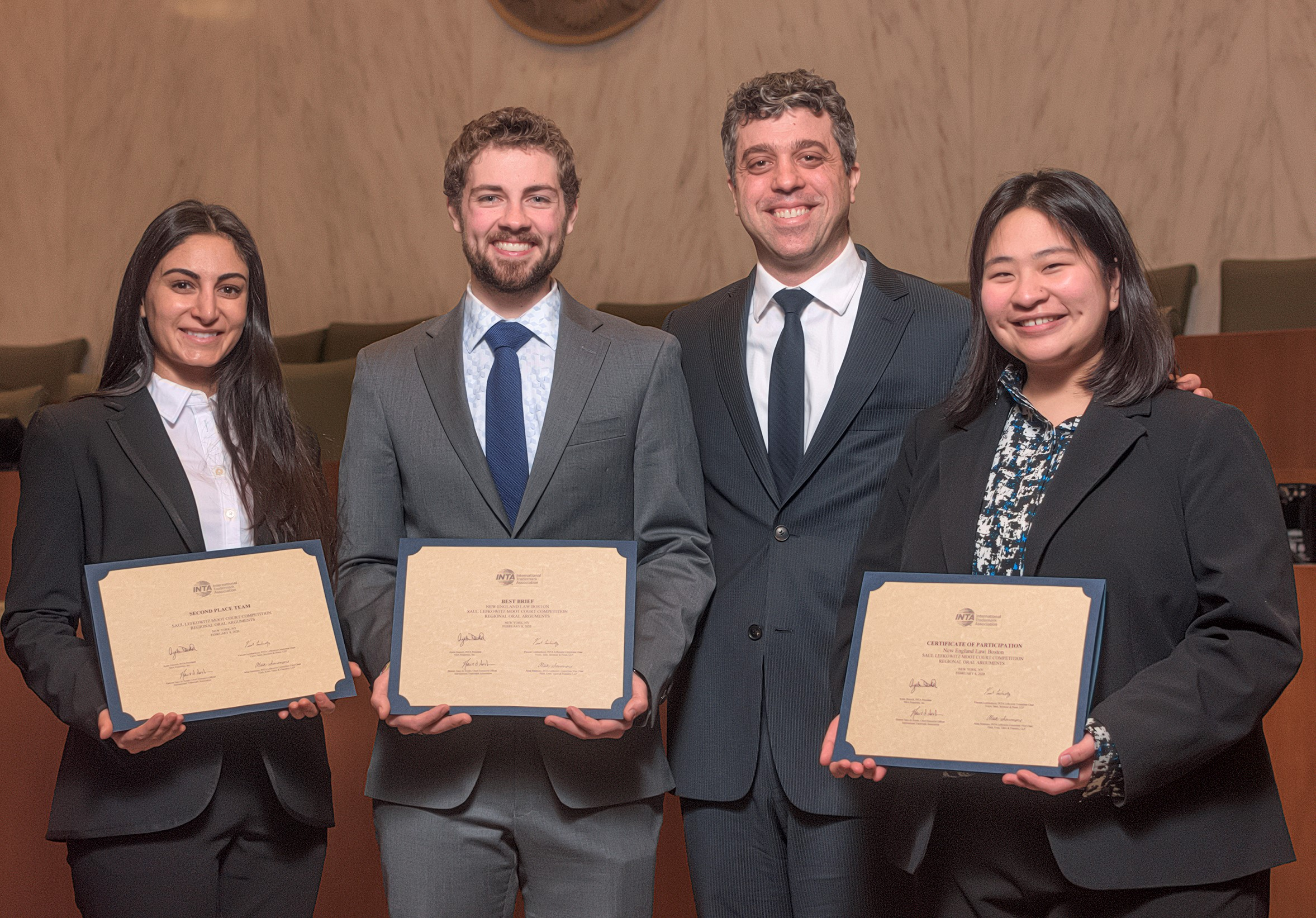 New England Law teams competing in moot court and college mock trial competitions